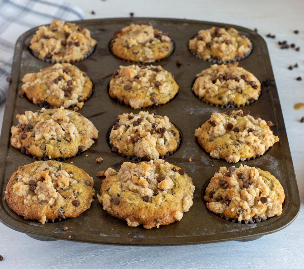 chocolate chip banana muffins in a muffin tin
